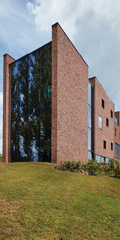 Circular Brick House by AST 77 Architecten pays an ode to rammed earth
