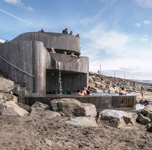 Basalt Architects' Guðlaug Baths in Iceland is a geothermal pool with ocean views