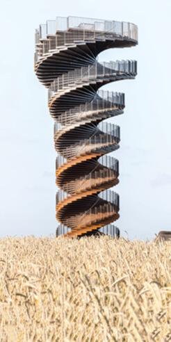 BIG's corkscrew like observation helix rises over Denmark's rugged landscape