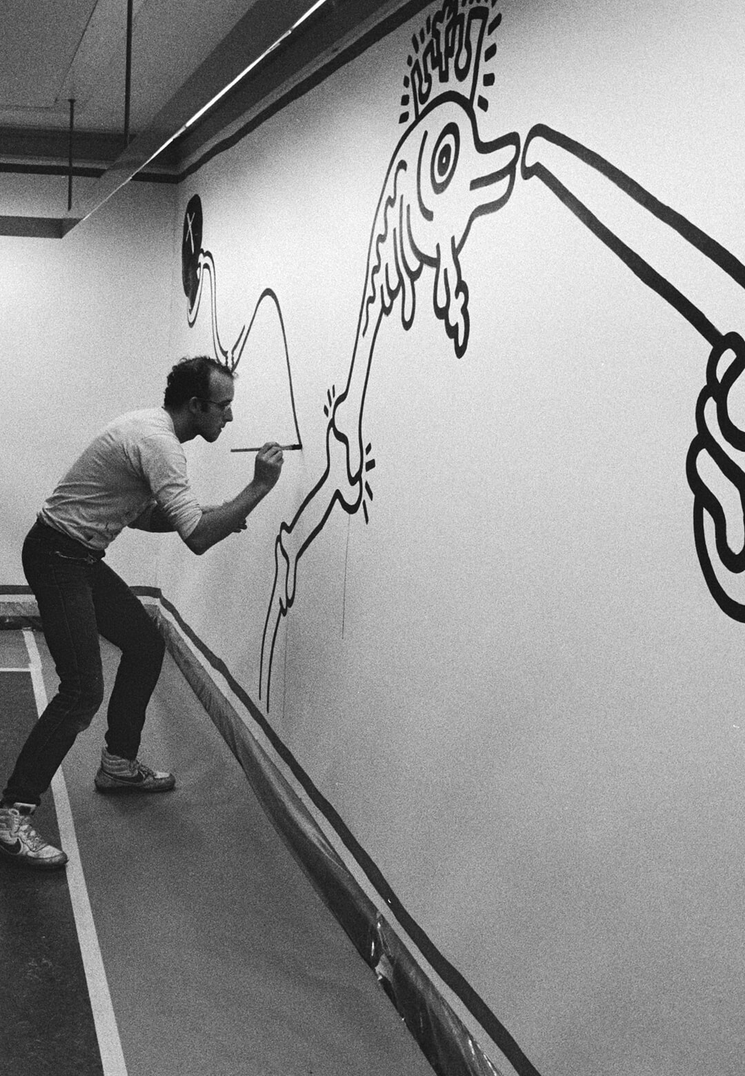 Keith Haring working on an installation in 1986 | Keith Haring | STIRworld