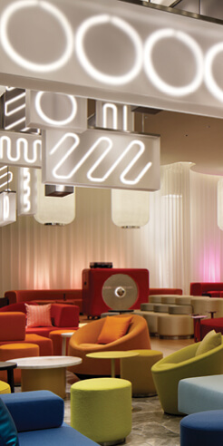 Concrete juxtaposes Japanese minimalism and saturated neon in Osaka's new W Hotel