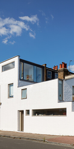 Cox Architects paint a residence in London with limewash to achieve matte finish