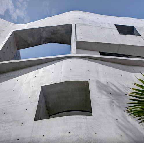 Is it a house or block of exposed concrete? Durbach Block Jaggers work the craft