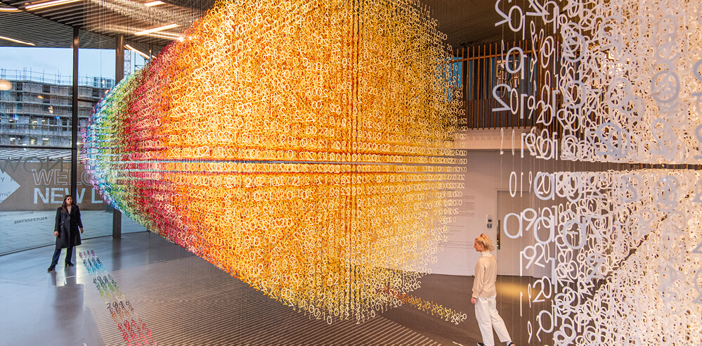Emmanuelle Moureaux hangs colourful numbers for 'Slices of Time' in London