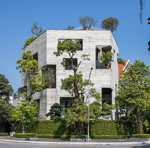 VTN Architects packs a concrete villa with trees on its double skin façade in Vietnam