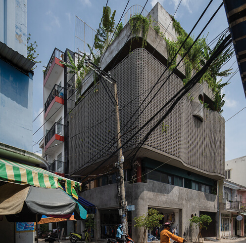 Hoa's House in Vietnam by H.2 Architects is a melange of greys and greens