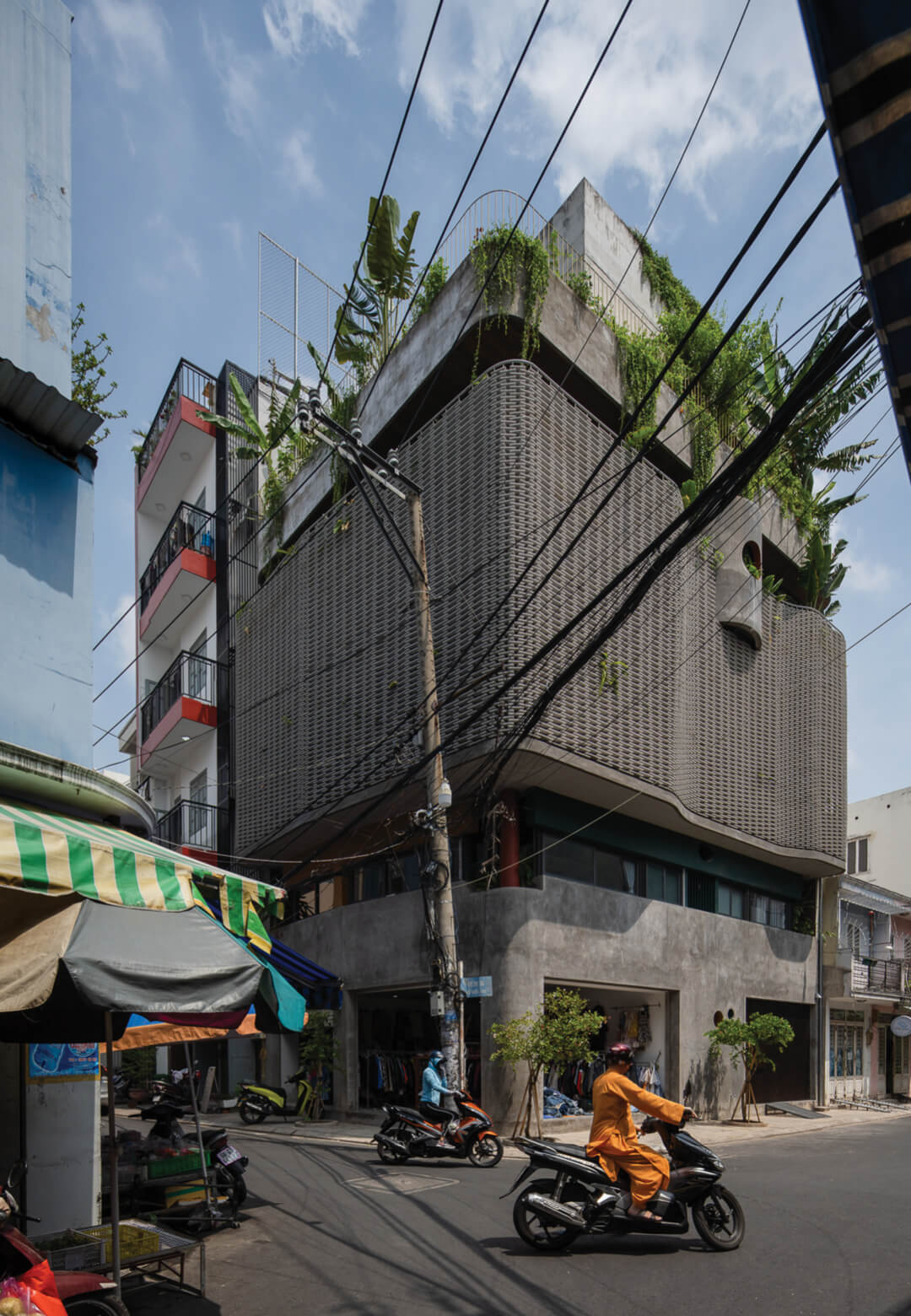 Hoa's House by H.2 Architects is a green haven framed within a latticed screen   Hoa's House   H.2 Architects   STIRworld