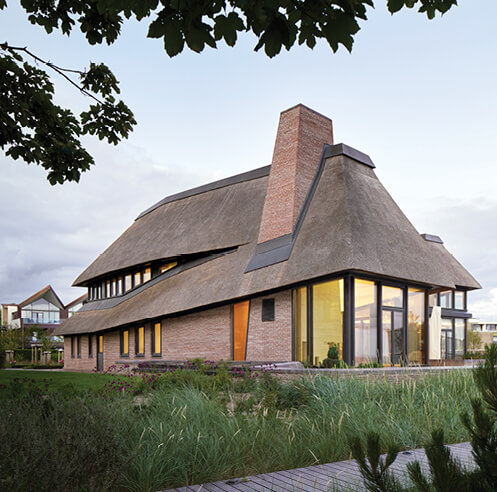 HUBSCHMITZ Architekten's holiday home in Föhr takes cues from Frisian farmhouses