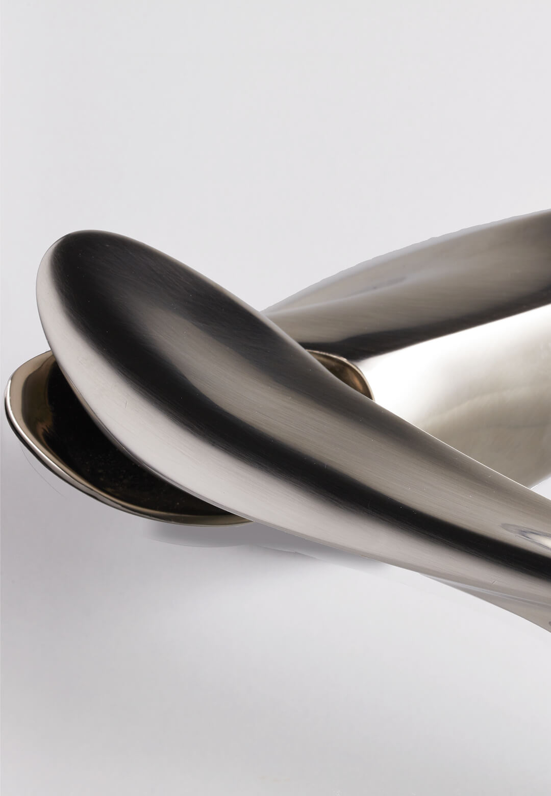 The NEXXA door handle in satin finish created by Zaha Hadid Design | Zaha Hadid Design | NEXXA | STIRworld