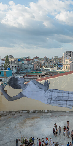 Jean René pays a giant tribute to a little boy through his wall mural in Havana