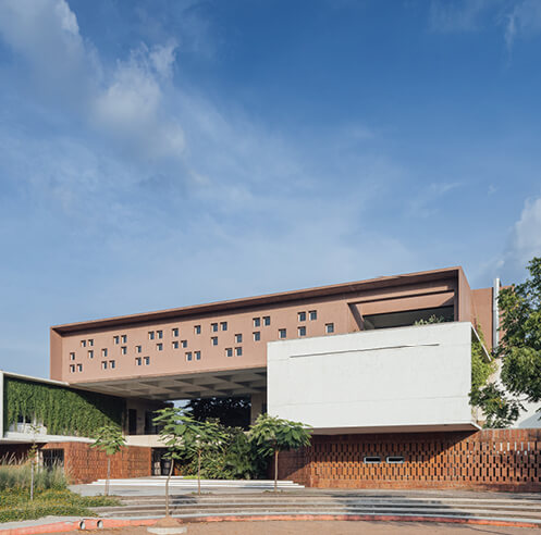 Green courtyards encircle learning zones in Shanmugam Associates' Northstar School