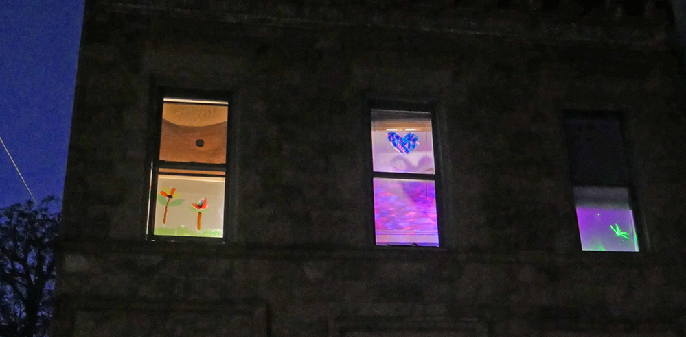 Light-art windows send out message of hope to passers-by amid COVID-19 isolation