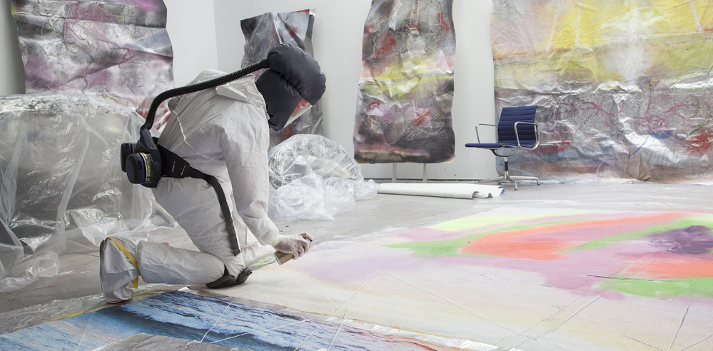 Marc Quinn uses blood in his installation to draw attention to the refugee crisis