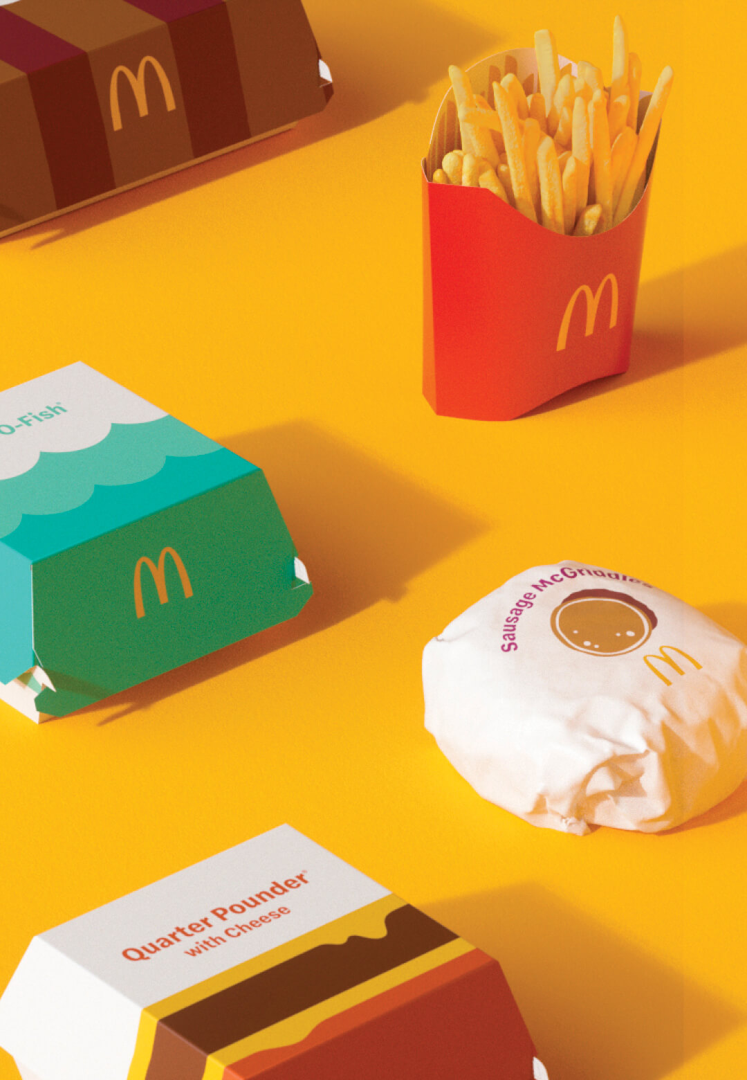 Redesigned packaging for McDonald's by Pearlfisher | McDonald's global packaging redesign by Pearlfisher | STIRworld
