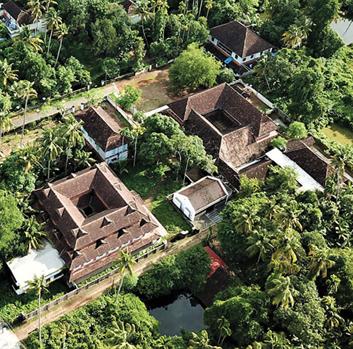 Meister Varma Architects design home in Kerala that camouflages in its context