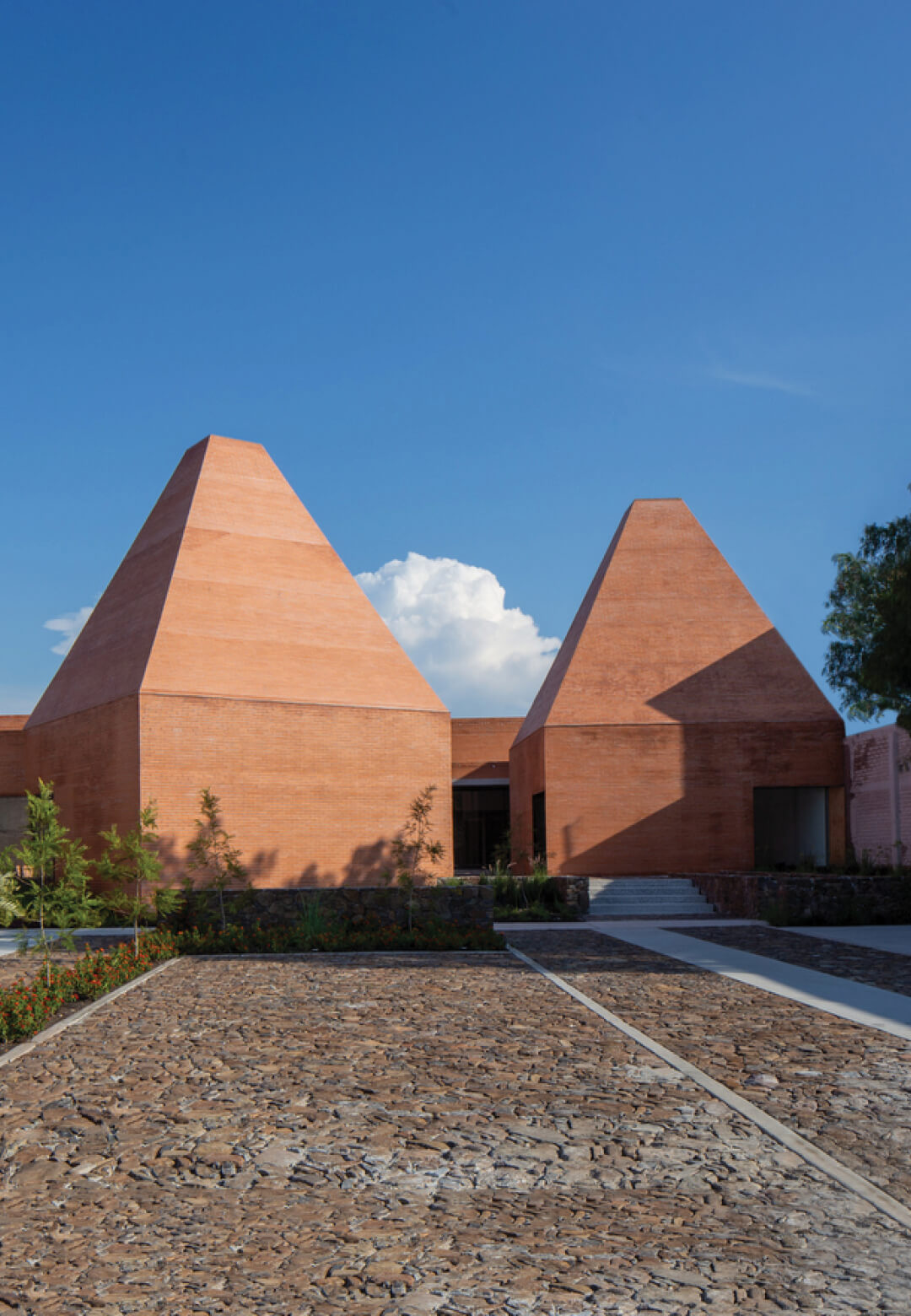 Two terracotta-coloured pyramidal volumes form Módulo de Riego conceived by 3ME Arquitectura | Módulo de Riego by 3 ME Arquitectura | STIRworld