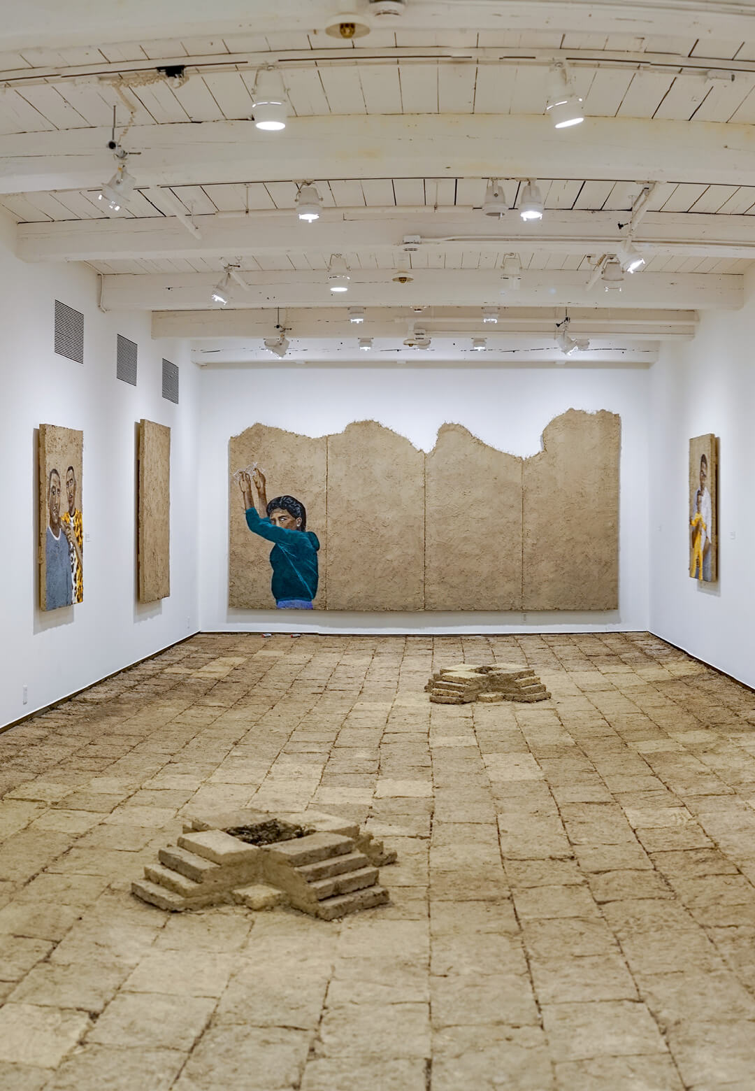 An installation view of Rafa Esparza's staring at the sun at MASS MoCA, with adobe bricks | Staring at the Sun | Rafa Esparza | STIRworld