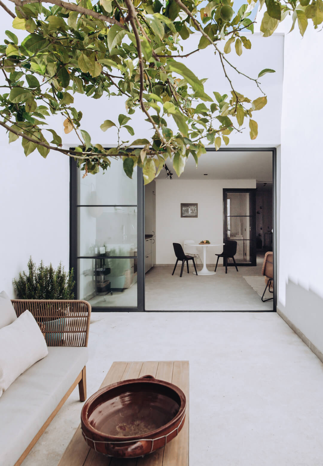 A private patio extends from the living room, bringing in natural light to the Portixol | Home designed by PMA Studio | Portixol House by PMA Studio | STIRworld
