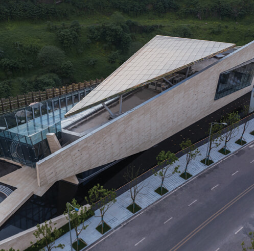 Angular planes, cantilevered glass, and folded metal sheathe One Sino Park by aoe