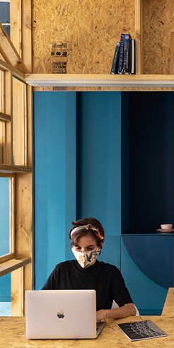 Oriented Fibres office in Ecuador features Pantone blue walls and pine wood shelves