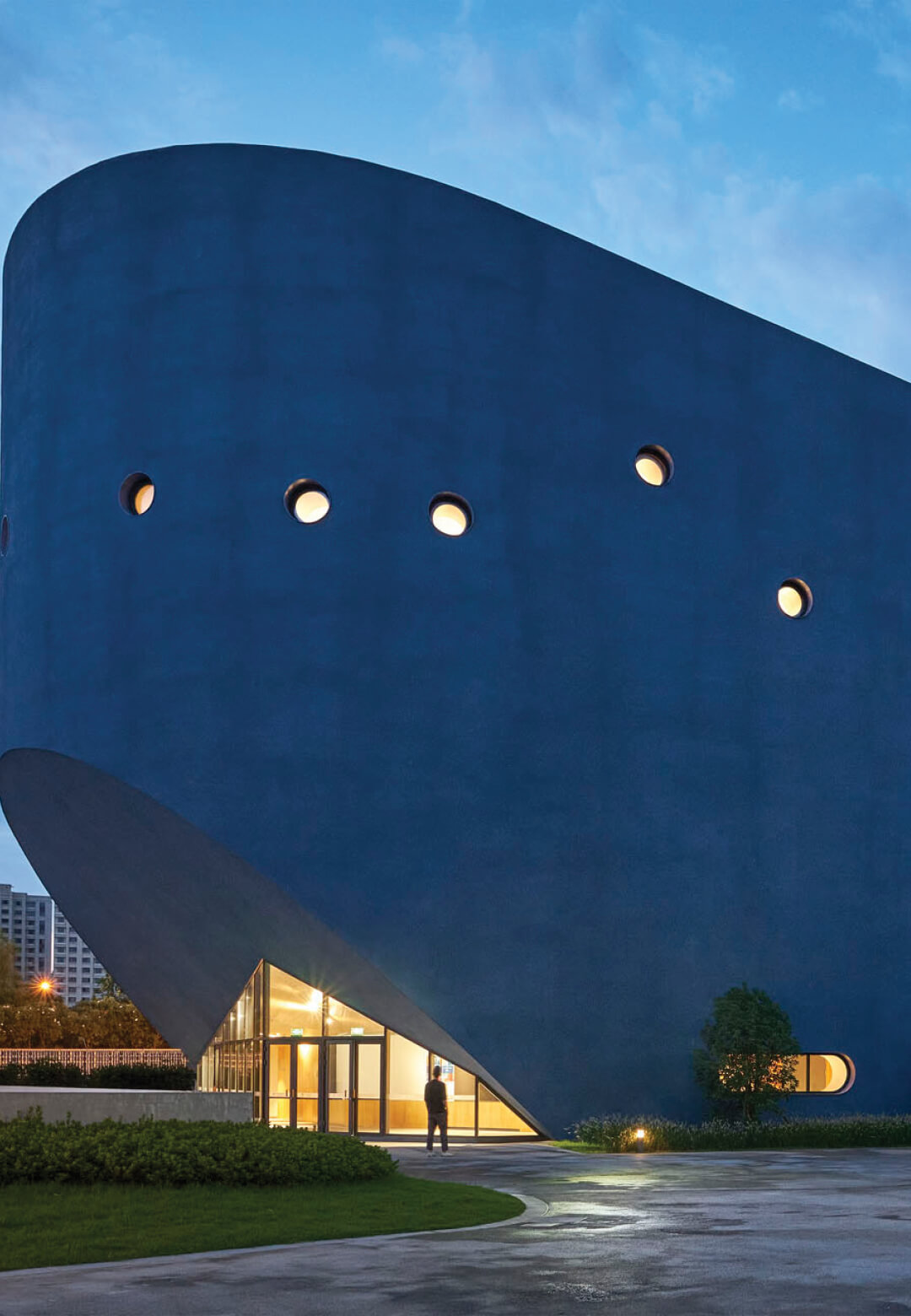 The Pinghe Bibliotheatre by OPEN Architecture appears to emulate the shape of a blue whale or an ocean liner | Pinghe Bibliotheatre| OPEN Architecture | STIRworld
