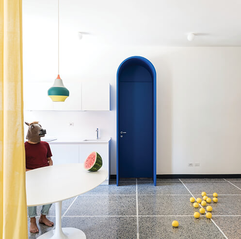 Playful, theatrical colours set stage in Retroscena by La Macchina Studio