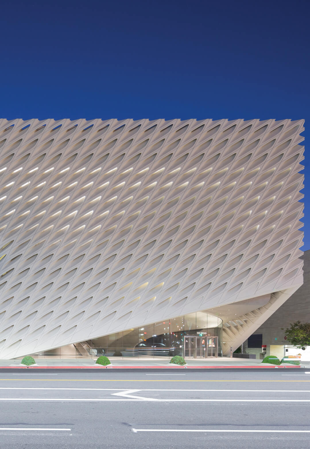 The Broad is a sedate yet impressive structure wrapped in a perforated exoskeleton that lifts on two sides to allow entry and exit | The Broad by Diller Scofidio + Renfro | Private Museums of the World | STIRworld