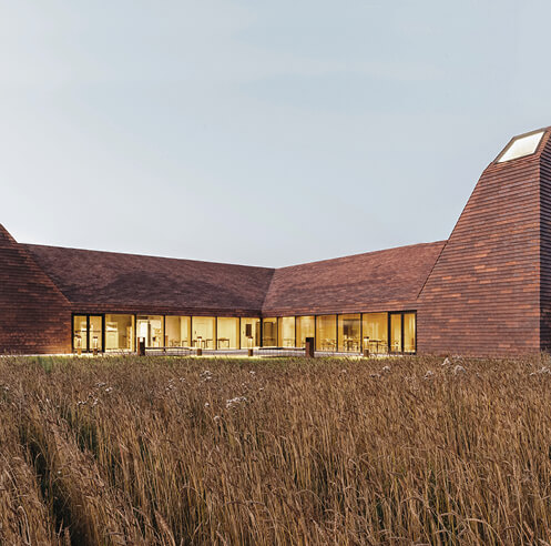 RRA reinterprets baking kilns into light wells in Denmark's 'House of Grain'