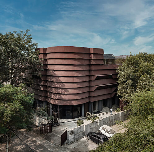 Rug Republic HQ in Delhi by Architecture Discipline emerges as a striated steel shell