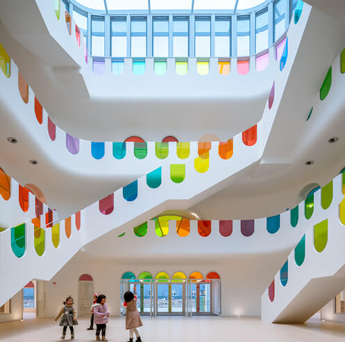 SAKO Architects adorns Kaleidoscope kindergarten in China with colourful glass