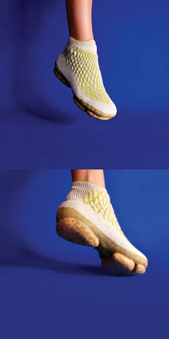 Sneature is a bio-shoe with a mycelium sole and a 3D-knitted canine hair body