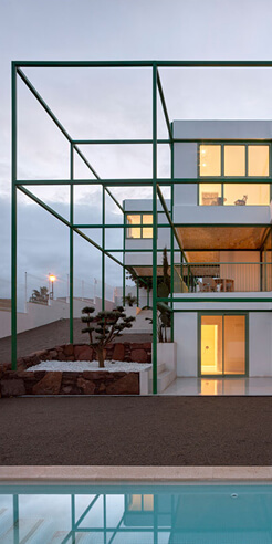 Green steel grid embraces the Brick Vault House by Space Popular in Valencia, Spain