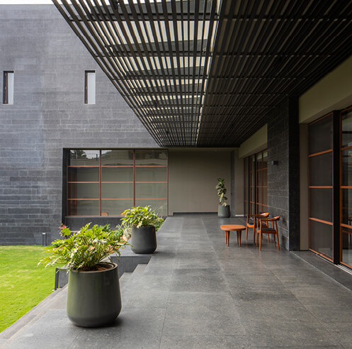 SPASM Design builds fort style dwelling with Black Bastion House in Coimbatore, India