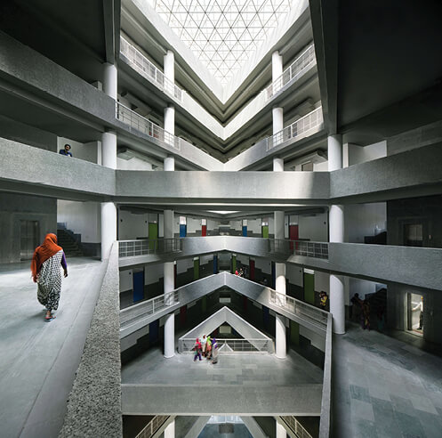 Sunken courts and crisscrossing bridges feature in a hostel in India by Charged Voids