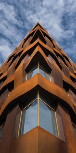 TCHOBAN VOSS Architekten's Ferrum 1 features a sculptural corten steel facade