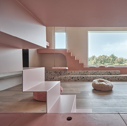 KC Design Studio immerses Cat's Pink House in Taiwan in bubblegum hues