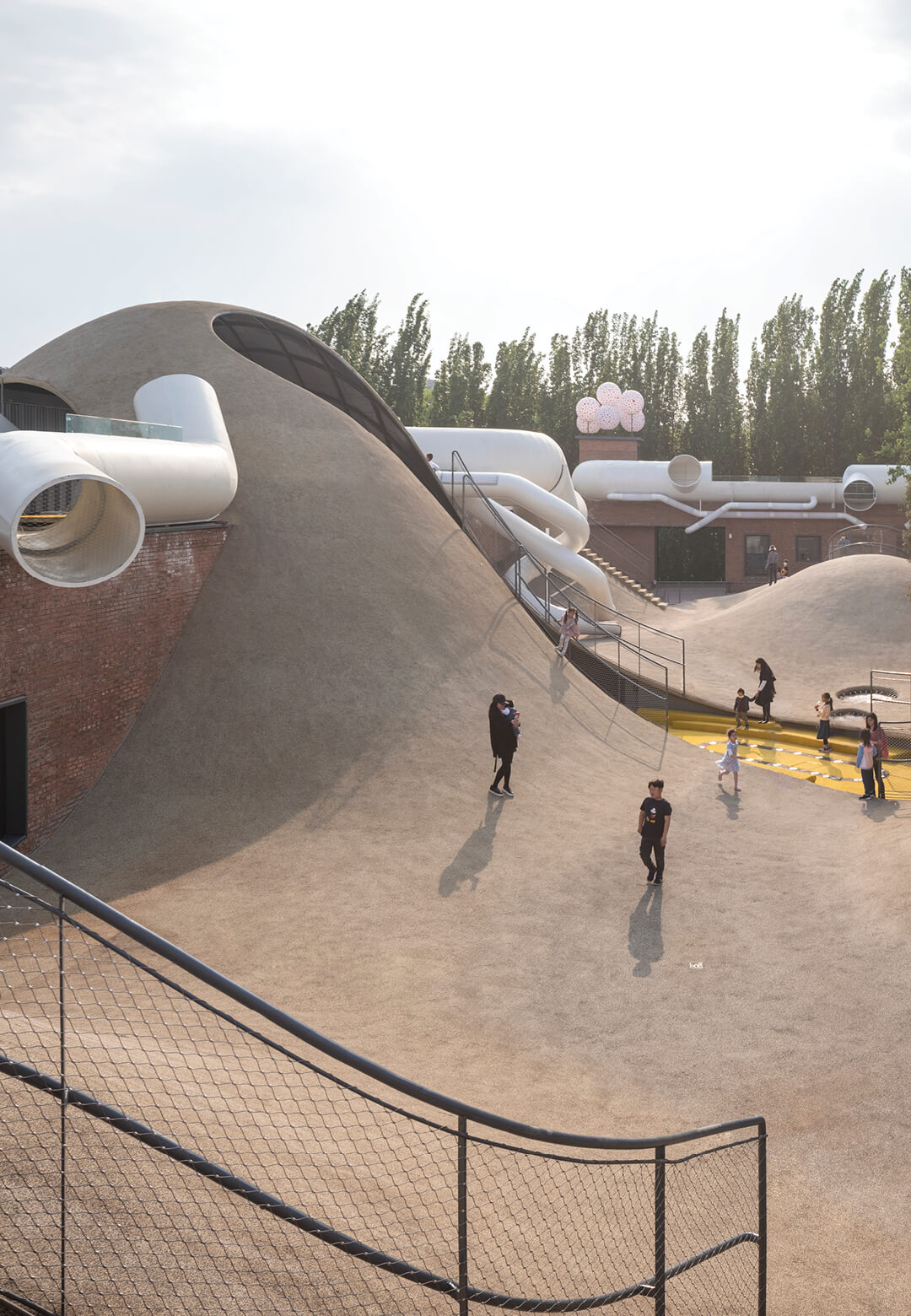 we architech anonymous (waa) refurbishes a former warehouse complex in Beijing into The Playscape - a children's community centre   Children's Community Centre  - The Playscape by We Architech Anonymous   STIRworld