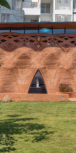 The Red Oasis by PMA madhushala cites vernacular architecture in rippling brick
