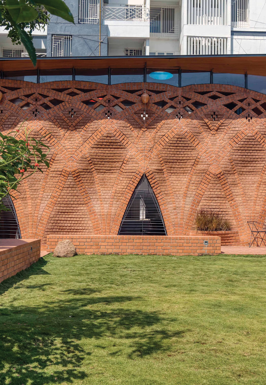 The distinct rippling façade of the Red Oasis designed by Indian architectural and design firm PMA madhushala | The Red Oasis by PMA madhushala | STIRworld