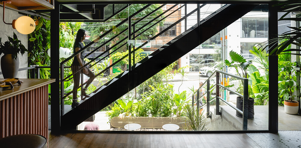 A5 Arquitectura inserts an industrial staircase outside The Somos in Medellín