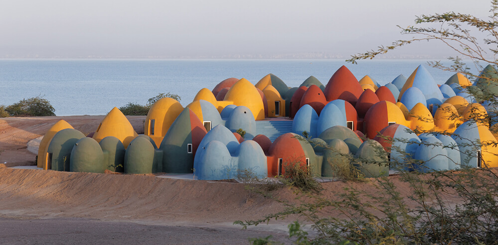 ZAV Architects designs a community cluster of crayon-like homes in Hormuz, Iran