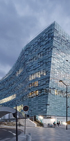 Twenty thousand glass tiles glitter upon Snøhetta's Le Monde Group HQs in Paris
