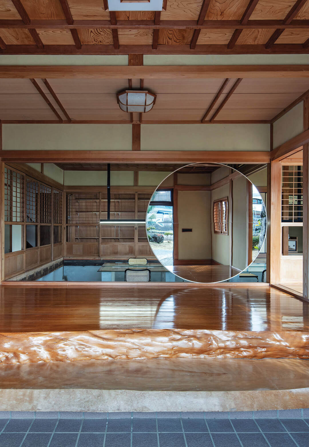 """Japanese firm DDAA has converted an 86-year-old wooden house into the new office for Maruhiro 