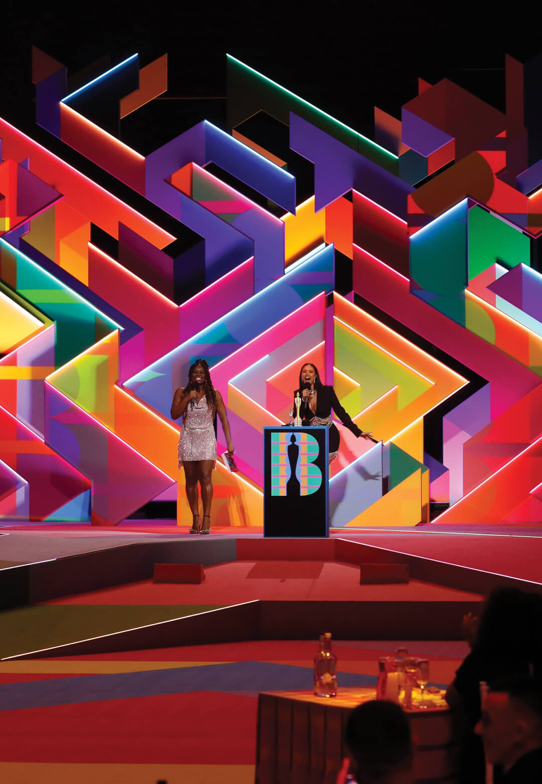 The 2021 BRIT Awards, held at London's O2 Arena, heralded the return of indoor events with a dazzling set design characterised by a maze of coloured volumes | Yinka Ilori and Es Devlin podium design for the 2021 BRIT Awards | STIRworld