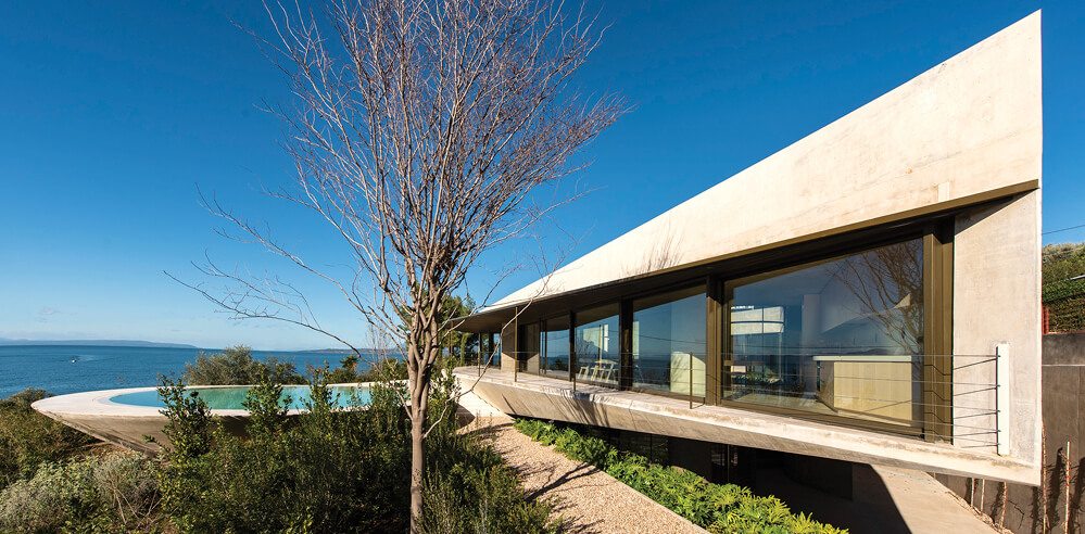 Exposed concrete and assertive geometry inform this Greek Residence in Euboea