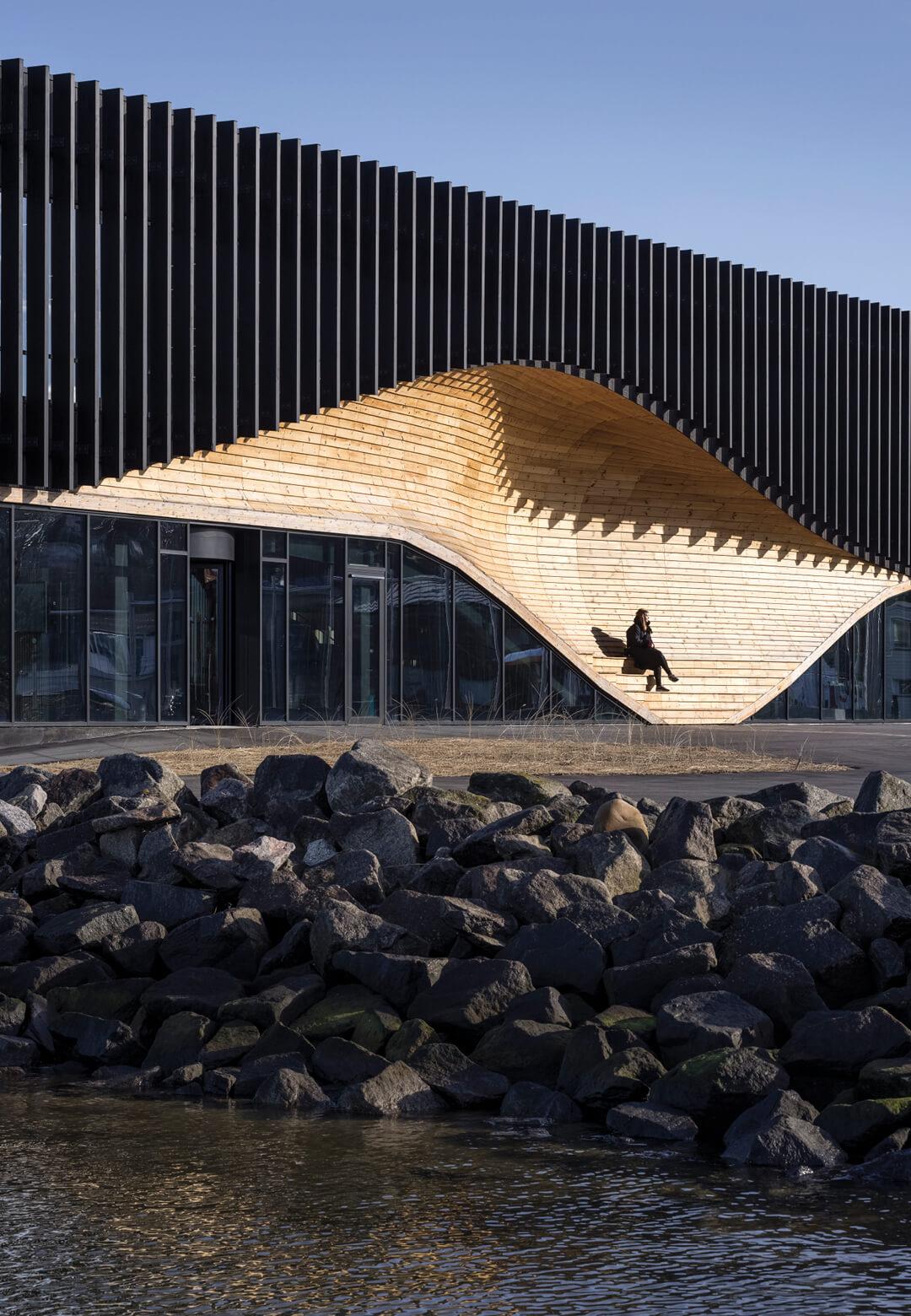 A wave shaped pocket dresses the exterior of the Lemvig Klimatorium in Denmark designed by 3Xn | Lemvig Klimatorium by 3XN | STIRworld