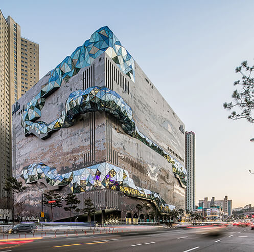 OMA creates multifaceted glass route at The Galleria store in Gwanggyo, South Korea