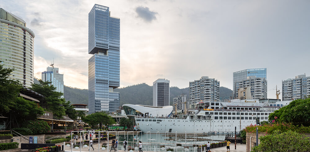 Sky decks connect OMA's Prince Plaza in China to skyscrapers, mountains and sea