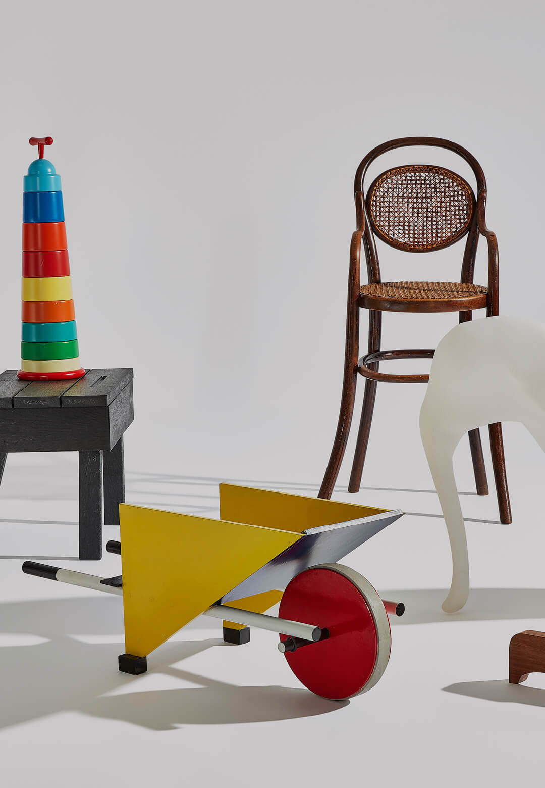 Clockwise: Michael Thonet's highchair, Richard Hutten's Low-res Elephant, Enzo Mari's puzzle 16 animali, Gerrit Rietveld's child's wheelbarrow, Ineke Hans's Office Desk and Chair and Torre di Mosto's  Magis Post-Computer | STIRworld