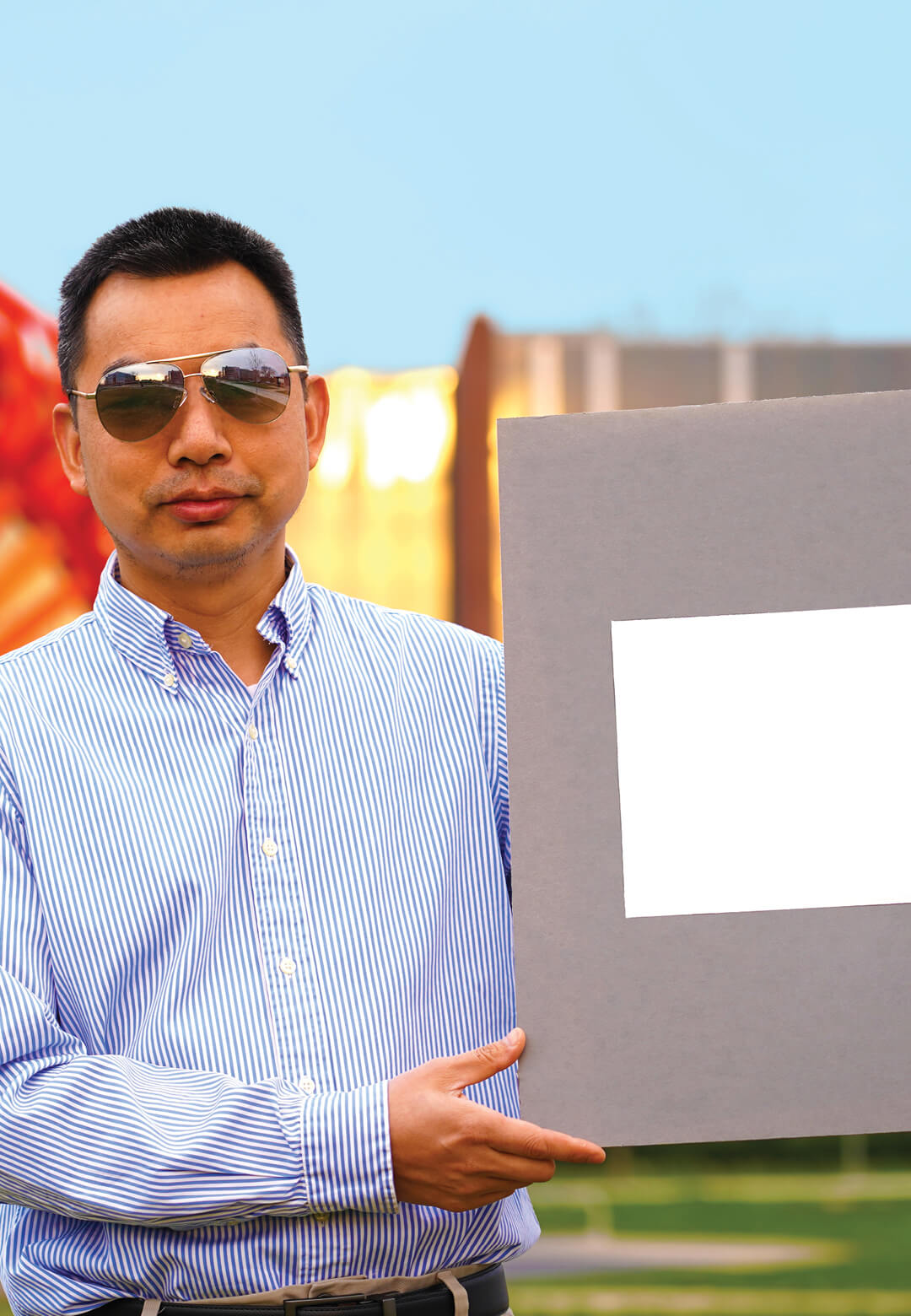 Xiulin Ruan, a Purdue University professor of mechanical engineering, holds up his lab's sample of the whitest paint on record | Ultra White Paint by Xiulin Ruan at Purdue University | STIRworld